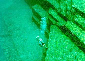Diver near pyramid